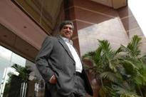 Govt ropes Nilekani for currency clean up