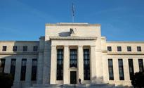 Fed officials see quick economic boost from Trump, risks to follow