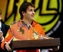 Santoro rejects claim Djokovic threw match