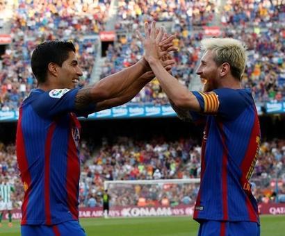 Suarez treble and Messi double lift six-goal Barca