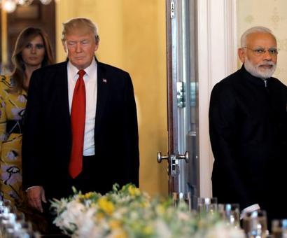 PHOTOS: Trump hosts dinner for Modi