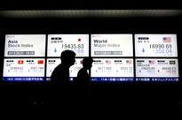 Asian stocks rise on back of Wall Street; gold slips