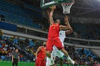 Spain get first win after security scare