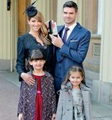England cricket player James Anderson poses for pictures with his family