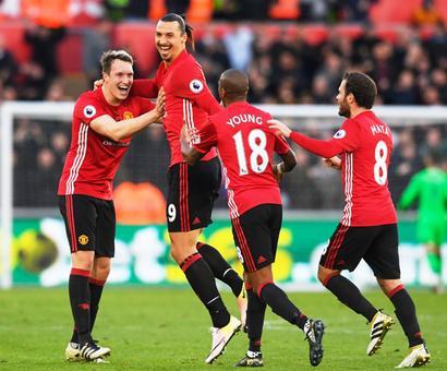 Manchester United top world football money list