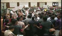 Congress MLAs disrupt Telangana Assembly, throw paper at Governor