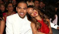 Could Rihanna & Chris Brown Be Getting Back Together? Her Dad Likes Him Despite What Happened