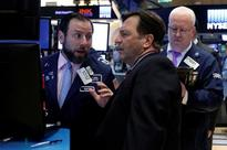 Wall Street earnings strength enliven investors, industrials a surprise