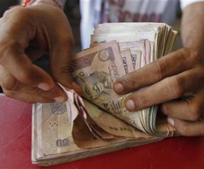 Rupee hits over 2-week low of 67.35, drops 27 paise