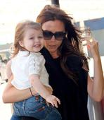 Beaming Harper Beckham heads to Paris for dad's birthday