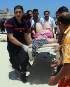 UK, Tunisia honour 38 victims of beach resort attack