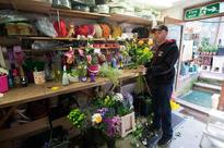 British florist sees rosy future in Brexit Florist Damian Duffy pictured as he prepares flowers in his shop in Watford,...