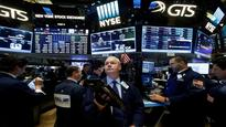Wall Street dips before French election, but up for week