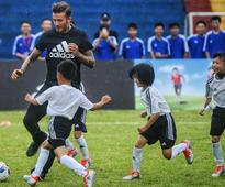 David Beckham promotes football in South China school