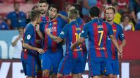 Suarez gives Barcelona edge in Supercup