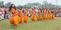 Tribals youths performing traditional Bodo dance