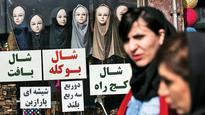 Unveiled! Half of Iran says no to head scarves
