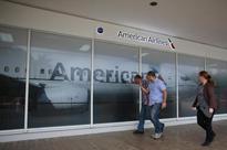 UPDATE 1-American Airlines to trim Cuba flight schedules