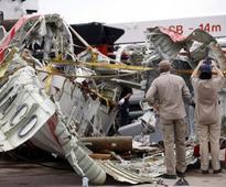 AirAsia captain left seat before jet lost control - sources
