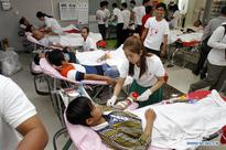 People donate blood on Valentine's Day in Cambodia