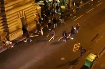 Terrifying moment massive migrant brawl explodes near Paris metro station as thugs hurl wooden pallets