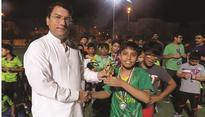 Taking community cricket to children
