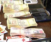 Raid on gambling den: Servitor among 12 held