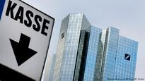 Deutsche Bank surprises with first profit in months