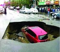 Chinese family car swallowed up by giant sinkhole