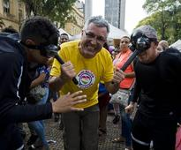 PHOTOS: Brazilians Disguised as Zika Mosquitoes Storm Opening Day of Carnival