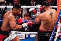Anthony Joshua defends his heavyweight crown by stopping Eric Molina in third round as Wladimir Klitschko bout is confirmed
