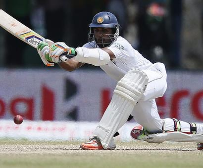 Bangladesh lose late wickets after Chandimal ton