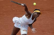 Serena, Venus advance to next round in Paris