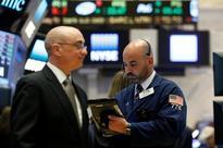 Wall Street ends flat as health bill passes; energy slammed