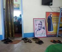 Idol worship TMC style: Mamata on the wall, Gandhi and Tagore on the floor