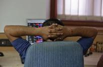 Sensex edges up; Infosys tumbles on revenue target cut