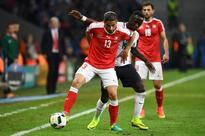 Puma blames faulty fabric for torn Swiss jerse... Switzerland's defender Ricardo Rodriguez (L) vies for the ball against F...
