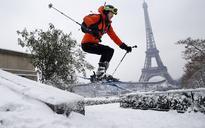 Paris grinds to a halt as rare heavy snowfall closes Eiffel Tower