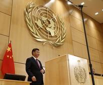 Xi portrays China as global leader as Trump era looms