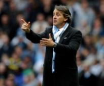 Manchester City fire coach Mancini