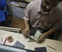 India's foreign exchange reserves slide from record high