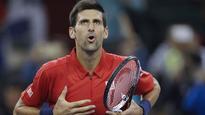 Agitated Djokovic averts Shanghai upset