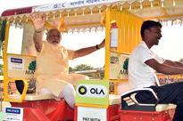 PM Modi in UP's Varanasi & Ballia: Launches Pradhan Mantri Ujjwala Yojana & e-boats; distributes e-rickshaws