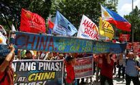 China vows to protect South China Sea sovereignty, Manila upbeat
