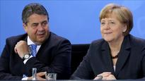 German coalition partner switches seats as poll looms