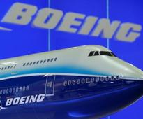 Boeing airplane unit to cut more jobs in 2017, shares rise