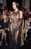 Kim Kardashian flaunts bizarre teeth jewellery and her ample cleavage in Paris Fashion Week selfie