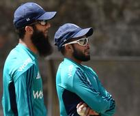 Battered bowlers hoping for respite, says Ali England's Moeen Ali (L) talks with Adil Rashid during training session a...