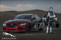 F1 star Martin Brundle and new Jaguar XJR take on high-flying Jetman' in world-first desert drag race