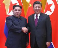 Kim Jong-un meets Xi, says North Korea 'committed to denuclearisation'